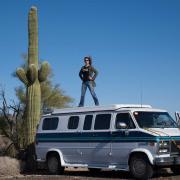 Jessica Bruder standing on top of her van