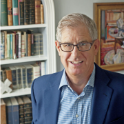 Galassi in front of a bookshelf