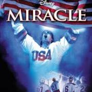 Miracle movie poster showing hockey player wearing USA jersey with hands up in victory