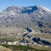 volcano crater and green valley below