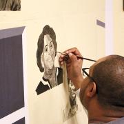 Kevin Saltau '01 painting the mural