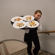 Meals being served at a Pindar Dinner