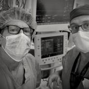 Two doctors in masks in an operating room