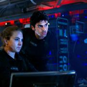 Two people aboard a futuristic spaceship