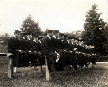 Graduates seated on the Class Fence, 1916