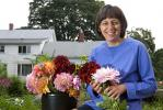 Marie Fowler displays some of her freshly-cut flowers at her home garden in Belchertown, Mass.
